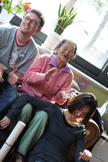 An elderly Korean woman, one of the comfort women, signing